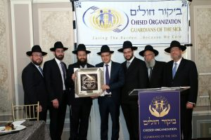 Hollander Family accepting the Tiferes Yehoshua Memorial Award in honor R' Shiya Hollander ז״ל