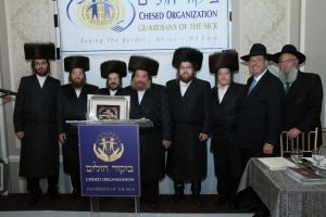 Mr. Shlomie Spierer, surrounded by his sons and son-in-law, with R' Avi Fishof and R' Yisroel Herskovits